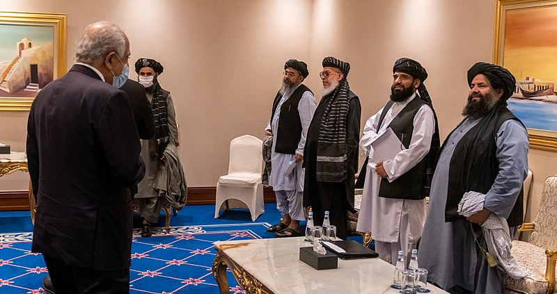 Taliban negotiators in Doha, Qatar, November 2020. On the left, wearing a gray suit and white mask, is Abdul Ghani Baradar, current abinet leader in Kabul. Photo: Ron Przysucha, U.S. Department of State, Public Domain